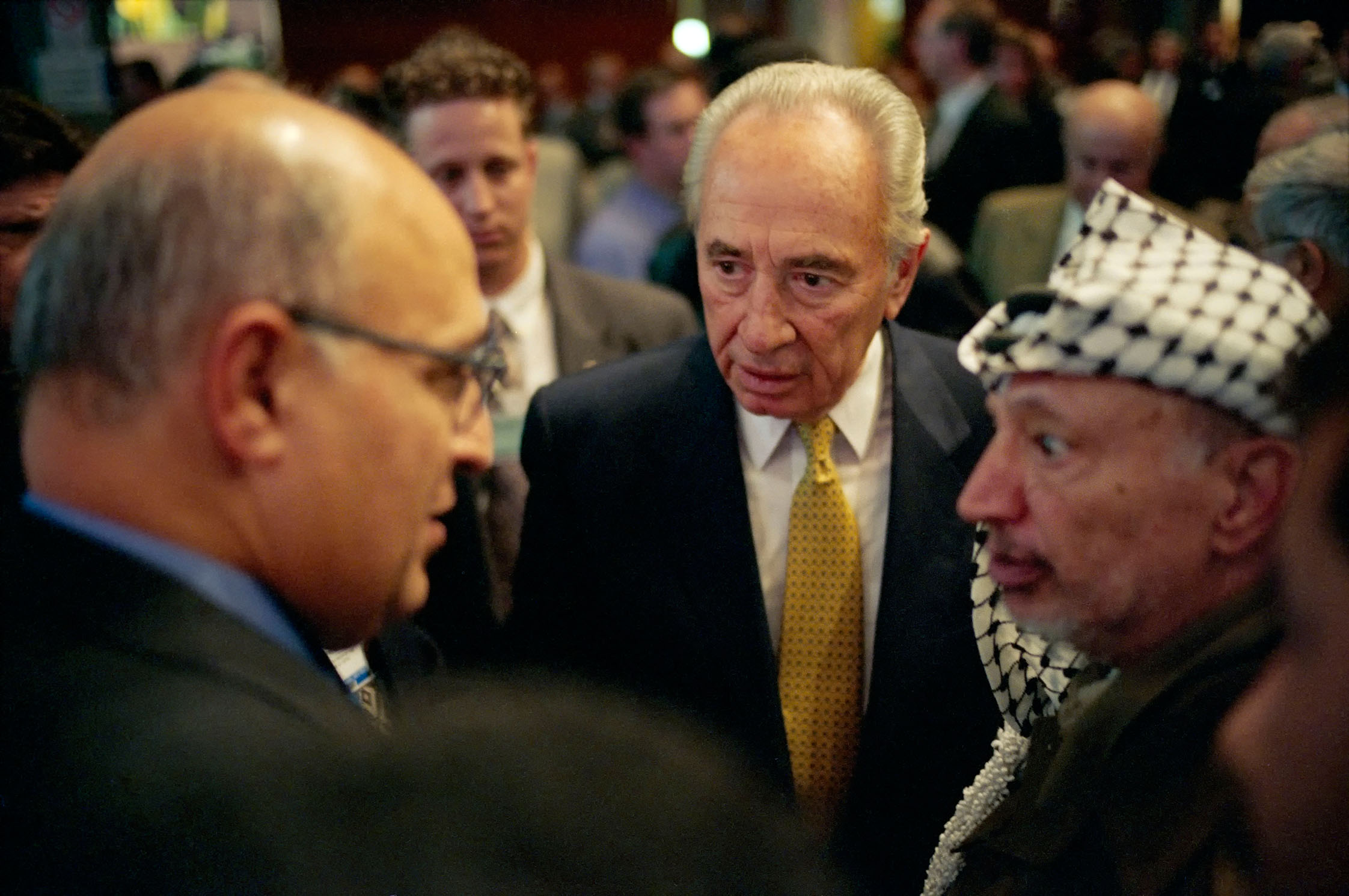 Nabil Sha\'ath (Palestinian Minister of Planning and Int\'l Cooperation), Shimon Peres (former PM of Israel) and Yasser Arafat (PNA).Contact email:New York : photography@magnumphotos.comParis : magnum@magnumphotos.frLondon : magnum@magnumphotos.co.ukTokyo : tokyo@magnumphotos.co.jpContact phones:New York : +1 212 929 6000Paris: + 33 1 53 42 50 00London: + 44 20 7490 1771Tokyo: + 81 3 3219 0771Image URL:http://www.magnumphotos.com/Archive/C.aspx?VP3=ViewBox_VPage&IID=2S5RYDKPWU1&CT=Image&IT=ZoomImage01_VForm