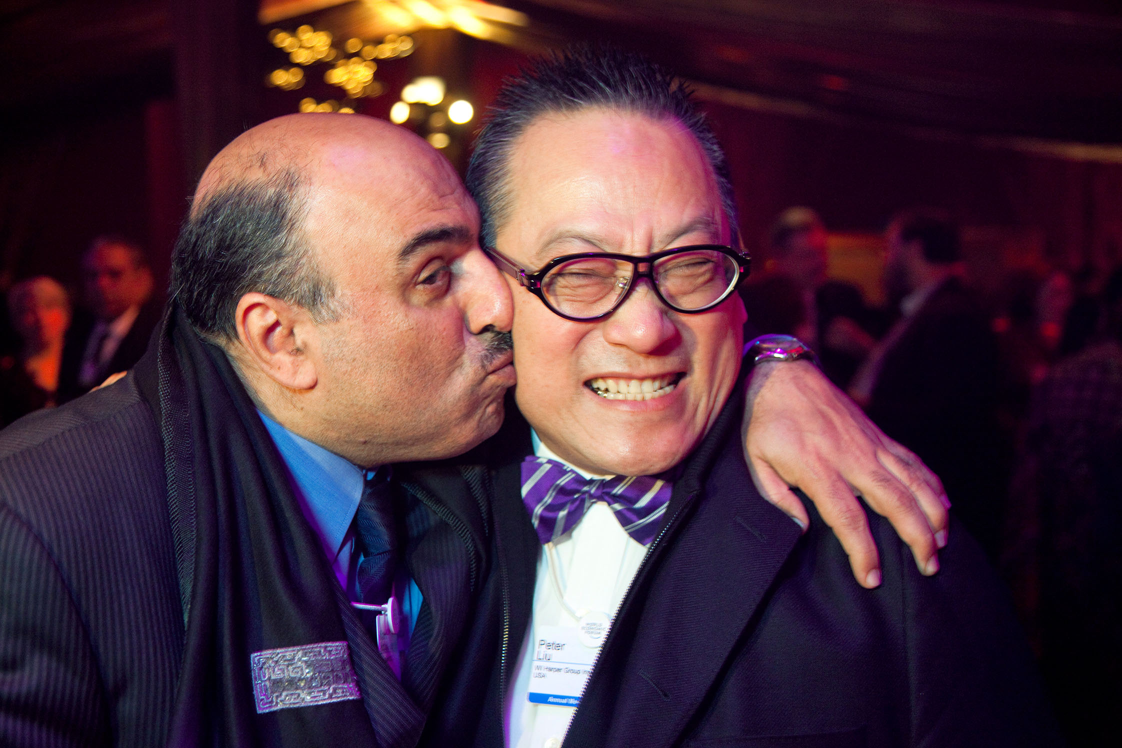 Moroccan Cultural Soirée.  Khalid ABDULLA-JANAHI, Chairman, Ithmaar Bank B.S.C., Bahrain, kissing Peter LIU, Co-Founder and Chairman, WI Harper Group Inc., USA.